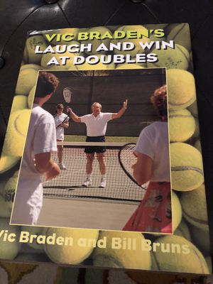 Tennis book and picture frame $10 for both. Book is Vic Braden's LAUGH AND WIN AT DOUBLES for Sale in Tampa, FL