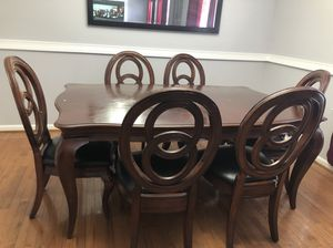 Wood and black leather dining table and 6 chairs for Sale in Hyattsville, MD
