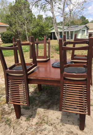 Kitchen table with 4 chairs one leg is broke on the table and one chair is broken but both can be fixs I paid 250 for it asking 60 for it for Sale in Spring Hill, FL