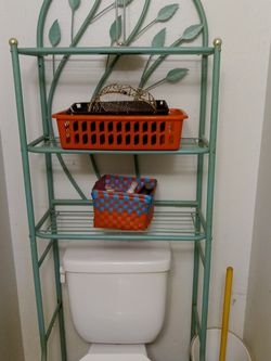 Just Reduced Again! $25 pastel soft mint green leaves motifs over the toilet seat caddy shelf set up lots of storage shelves space good condition! for Sale in Tarpon Springs,  FL