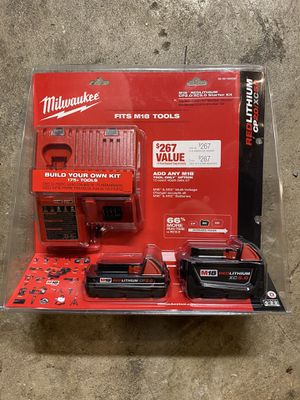 Milwaukee M18 5.0 and 2.0 ah battery with charger and bag for Sale in San Jose, CA