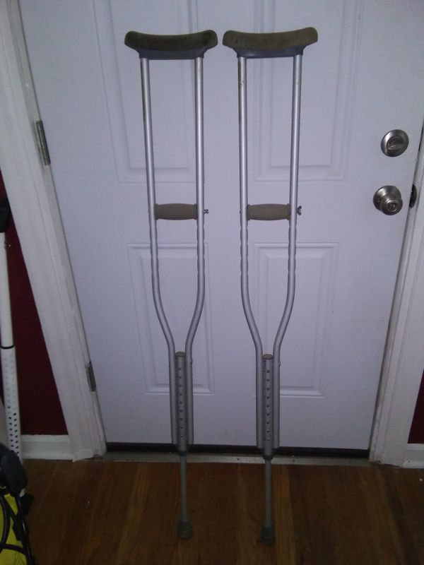"Set of Adjustable Crutches *for height 5' 2"" through 5' 10* ($3)"