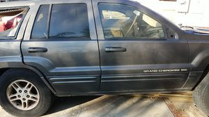 99 Jeep grand Cherokee for parts engine has knock rod transmission is good 4/4good trims and many parts let me know what you need for Sale in Fontana, CA