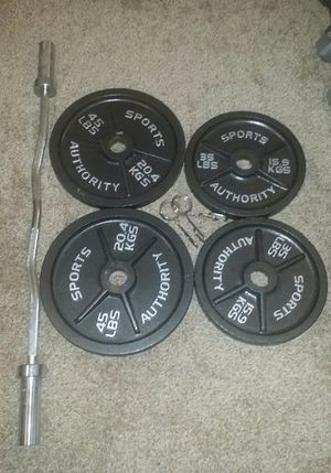 "Olympic 2"" weights with heavy duty curl bar. 2x45lbs, 2x35lbs and 2 weight clips. for Sale in Deerfield Beach, FL"