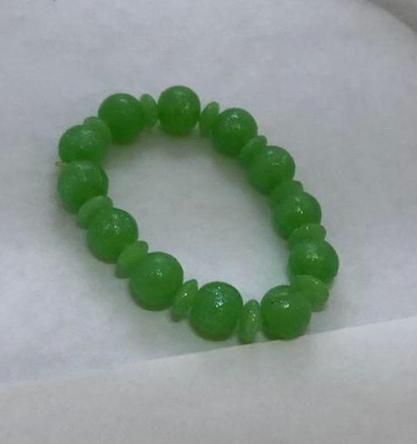 Green bracelet with sparkles