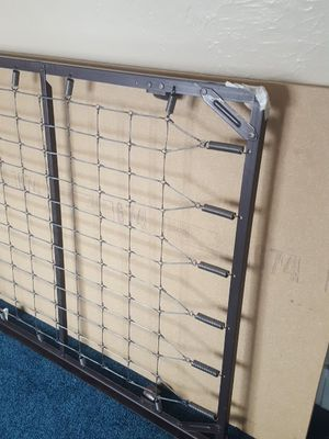Twin size bed frame with wheels/ board for Sale in Dearborn, MI