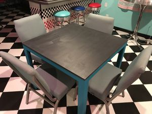 Solid wood table refinished with 4 cushioned chairs for Sale in Raleigh, NC