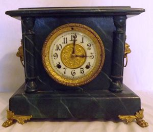 Mantle Clock Mechanical Wind Up Antique Wooden w/Brass Lions Claw Feet. for Sale in Exeter, CA