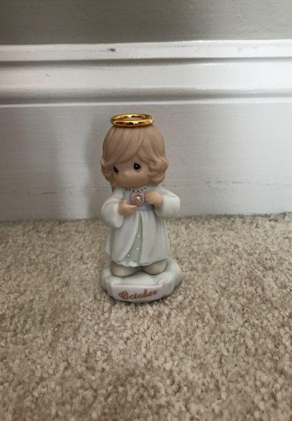 Precious Moments October figurine