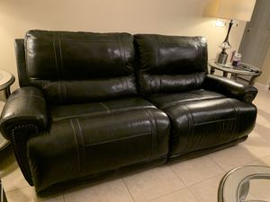 Double reclining black leather couch for Sale in West Palm Beach, FL
