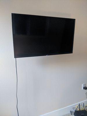 40 inch TLC Roku Flat Screen TV and Wall Mount for Sale in Seattle, WA