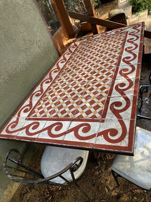 Wrought iron Moroccan tiled table… With free chairs for Sale in Los Angeles, CA