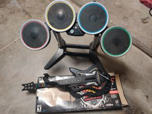 PS3 Warriors of Rock guitar plus free Xbox drumset for Sale in Glendale, AZ