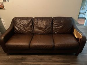 Free Entertainment Center Or Brown Leather Couch for Sale in Casselberry, FL