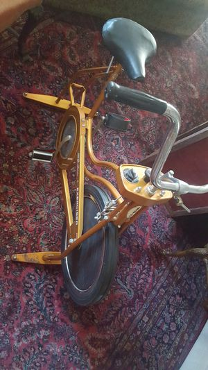 Vintage Schwinn Exerciser stationary bike. Copper color. Good working condition. for Sale in North Tonawanda, NY