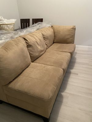 Sectional couch included with a square ottoman same color. for Sale in Loxahatchee, FL