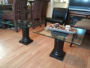 Nice 2 end tables, the glasse's is heavy's and black columns for Sale in Las Vegas, NV