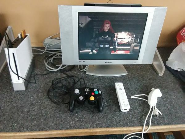 Wii bundle with Super smash Bros Controller included and Polaroid 15 inch LCD TV