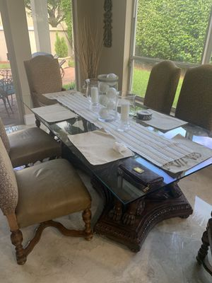 Antique style kitchen table with one piece glass top and lions carved into the base for Sale in Miami, FL