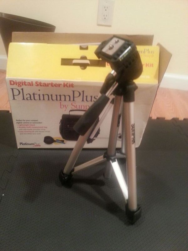 New, never used camera tripod and lens cleaner