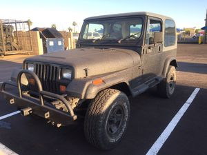 1988 Jeep Wrangler w/ Chevy 305 Motor, New Carb, Automatic Trans, New Rhinoliner, New Battery, and Good Tires for Sale in Mesa, AZ