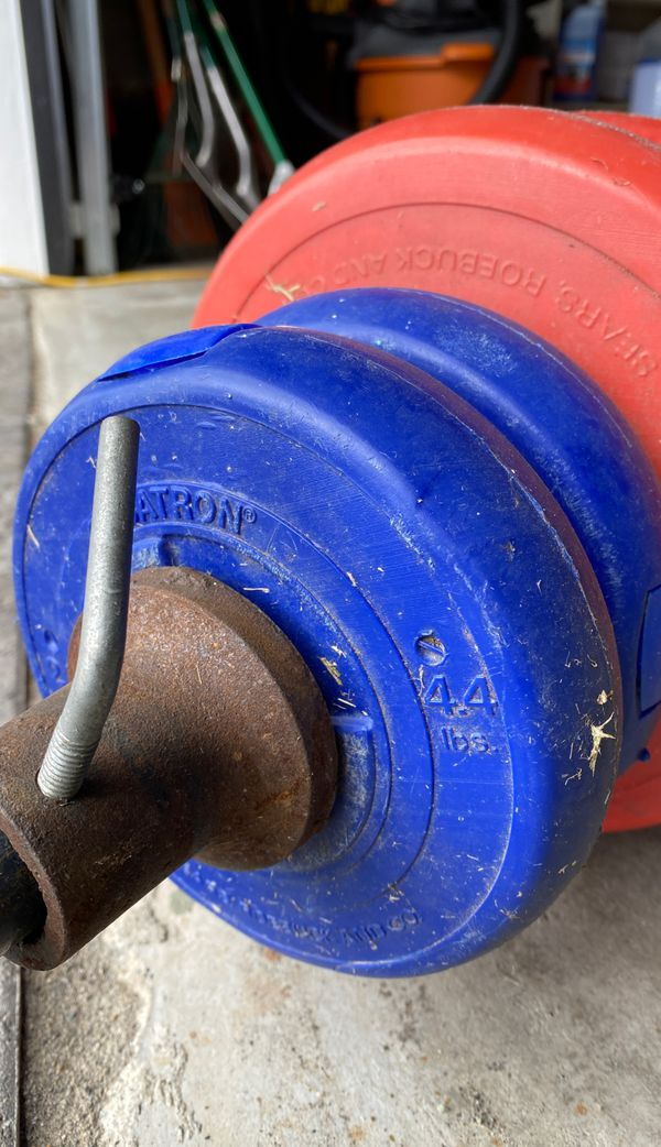 """Plastic/Cement weight, 1""""olympic bar, 2 curl bars, 100lbs of weights"""