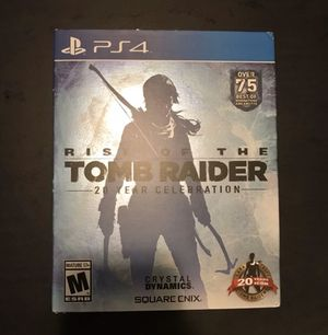 Rise of the tomb raider with art book ps4 for Sale in Columbus, OH