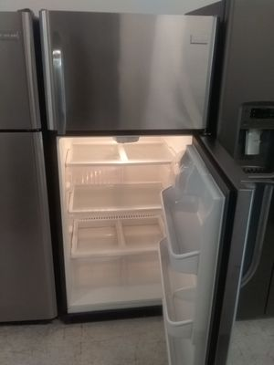 Frigidaire top and bottom stainless steel refrigerator used good condition 90days warranty for Sale in Mount Rainier, MD