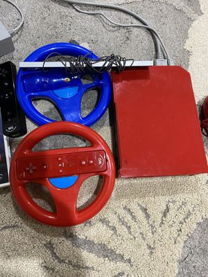Wii Console,games with controllers and wheel controllers for Sale in Baltimore, MD