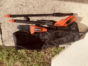 Black and decker expandable electric chain saw with battery and recharger for Sale in Palm Bay, FL