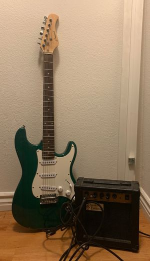 Electric Guitar (with amp and unopened strings) for Sale in Corona, CA