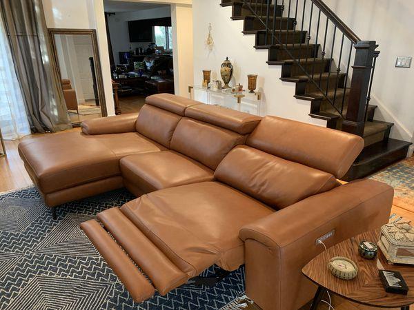Modani Thompson sectional motion tan sofa (left)