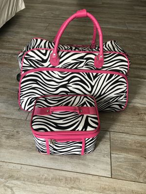 Zebra print rolling duffel bag/suitcase with toiletry/makeup bag for Sale in Mission Viejo, CA