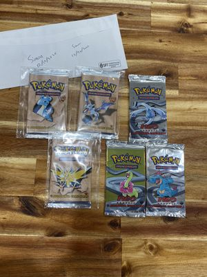 Neo Genesis and Fossil 1st Edition Sealed booster packs for Sale in Arlington, VA