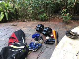 Baseball lot- includes boys cleats size 1 and 3. One glove, two bags, one pair socks, two helmets, two bats for Sale in Lake Worth, FL