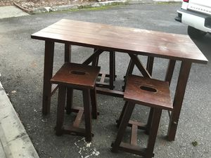 Small wood table with 4 stools. Pub height. Needs to be repainted to look new but in great condition. I will consider delivering for a few depending for Sale in Kent, WA