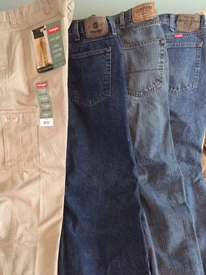 Lot of four pants/jeans sz 40x30 for Sale in Whitehall, OH