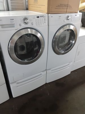 $699 LG washer and dryer set includes storage pedestals delivery in San Fernando Valley a warranty and installation for Sale in Los Angeles, CA