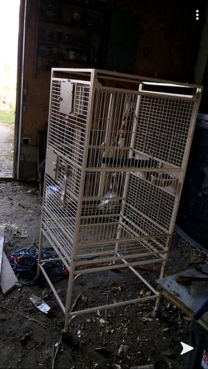 Huge nice bird cage with toys and food bowls we got the cage brand new for 500 hundred for Sale in Eureka, IL