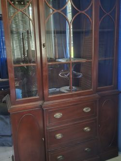 Very nice mahogany China cabinet with piano trim at the top for Sale in Summerfield,  FL