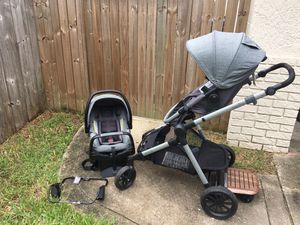 Evenflo Pivot Xpand double stroller with rider board for Sale in St. Petersburg, FL