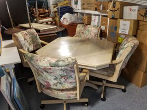 Dining table witb 4 chairs with casters for Sale in Pinellas Park, FL