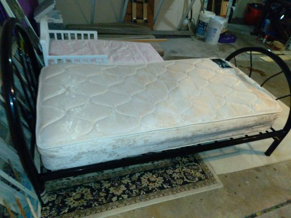Twin size bed frame and mattress. Not very old at all. Great shape.