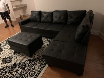 2303 Black Leather Sectional With Storage Ottoman  for Sale in Atlanta, GA