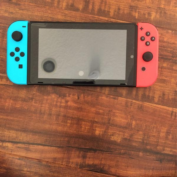 Nintendo Switch with carrier case and all cables