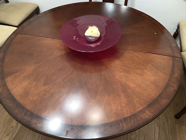 Beautiful almost new solid wood dining room table with insert, six chairs, and breakfast buffet.