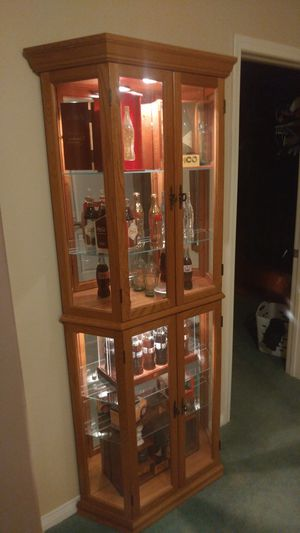 Solid Oak curio cabinet, comes filled with Coca-Cola Collectibles. for Sale, used for sale  Upland, CA