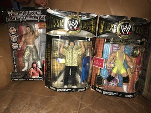 Wrestling collector fan? 3 brand New WWW Wrestling action figures all for $20 for Sale in Fresno, CA