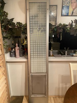 Large pet door with privacy film on glass for Sale in Phoenix, AZ