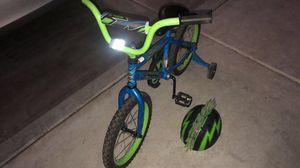 Kids huffy bike with training wheels and helmet for Sale in Phoenix, AZ